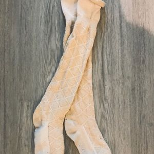 Over the knee cream socks